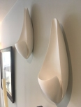 contemporary sculptural white plaster wall light, Curl Wall Sconce by lighting designer Hannah Woodhouse