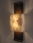 Side view of this bespoke architectural wall light by Hannah Woodhouse includes a beautiful hand painted lampshade